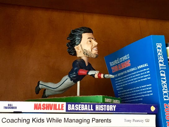Dansby Swanson bobblehead in Vanderbilt baseball coach