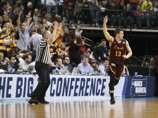 Loyola guard Clayton Custer celebrates a 3-point basket during his team's NCAA Tournament first-round matchup with Miami.