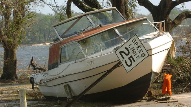 Boats of all types litter the streets of the Navy Point subdivision in Warrington after Hurricane Ivan came ashore Sept. 16, 2004.