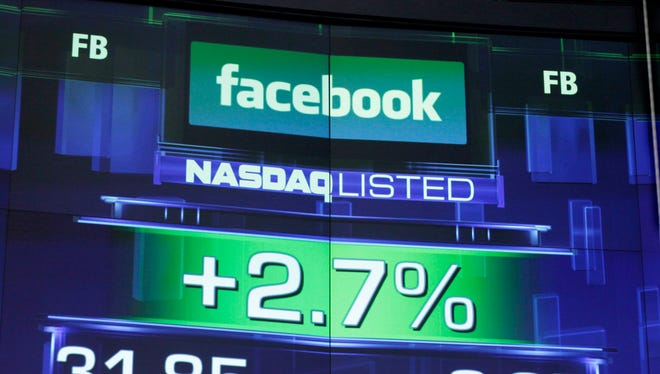The pre-market price for Facebook stock is shown at the Nasdaq MarketSite in New York.