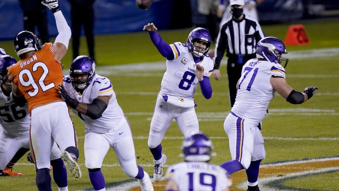 Minnesota Vikings quarterback Kirk Cousins (8) throws during the first half of an NFL football game against the Chicago Bears Monday, Nov. 16, 2020, in Chicago.