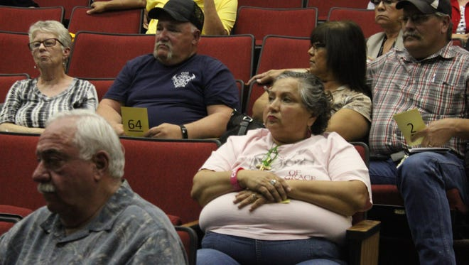 Lilia Santana listens to a presentation on repairs to US 285, March 22, 2018 at Loving High School. Santana's husband recently suffered a severe shoulder injury after a wreck on 285.