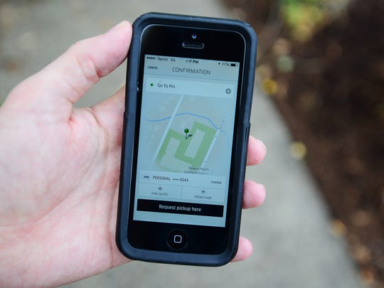 The Uber app as shown from an iPhone in downtown Salem, Ore., in October.