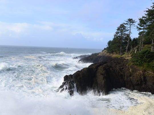 Waves crash against the cliffs at Cape Foulweather near Depoe Bay on Wednesday, Oct. 15, 2014.