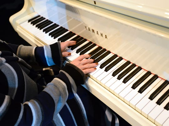 Soprano Carol Ann Manzi plays the piano while teaching voice at Blanchet Catholic High School. In addition to her passion for teaching, she is an opera singer, breast-cancer survivor and motivational speaker. She will give a free concert Dec. 9 at the Historic Elsinore Theatre.