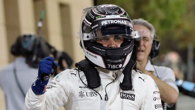 Valtteri Bottas celebrates after taking the pole position at the end of the qualifying for the Bahrain Formula One Grand Prix.