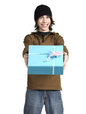 Teenage boy presenting gift.