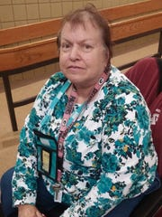 Wausau resident Mary Sann poses for a photo after a Transit Commission public hearing Oct. 22, 2014 at North Central Health Care Facilities.