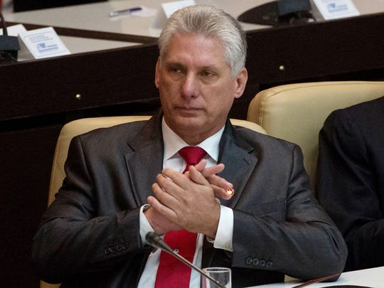 Cuba's new president Miguel Diaz-Canel, applauds during the speech of Cuban former president Raul Castro after he was formally named president.