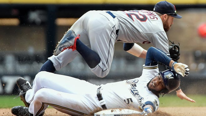 Cleveland Indians' second baseman Jason Kipnis (22) completes a double play after forcing out Milwaukee Brewers pinch runner Hector Gomez (5) in the ninth inning at Miller Park. The Indians beat the Brewers 7-5.