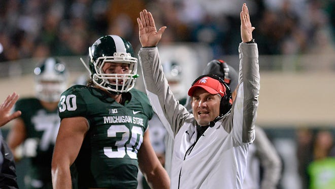 MSU assistant coach Mike Tressel celebrates an MSU fumble recovery late against  Nebraska  at Spartan Stadium October 4,  2014.
