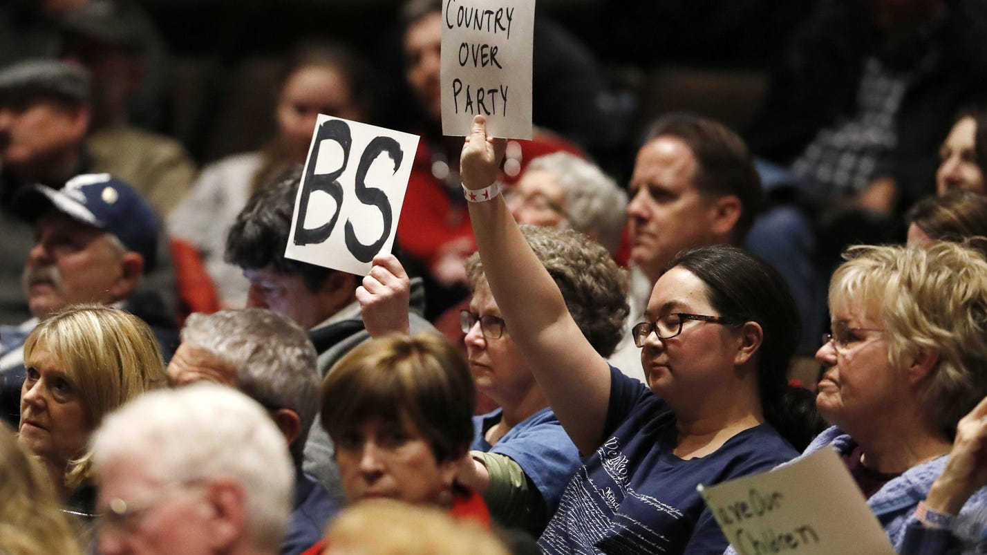 Colo. congressman booed as people demand action on guns