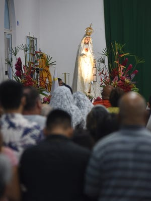 Parishioners and others gather for the Centennial Fatima Farewell ceremony held at the Immaculate Heart of Mary Catholic Church in Toto on Saturday, Sept. 9, 2017.