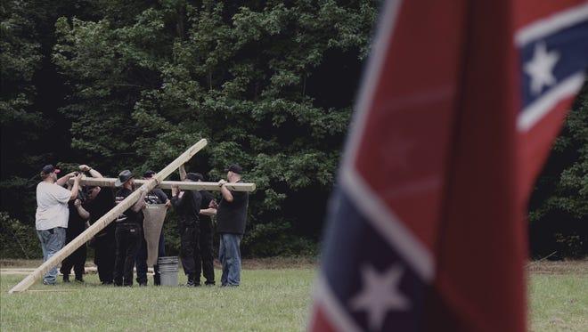 Klan members of North Mississippi White Knights take part in a KKK ceremony on 'Generation KKK' premiering Jan. 10 on A&E Network.