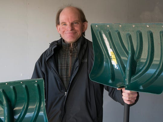 Jim Crowley posing with his snow shovels back in 2018.