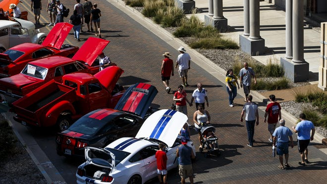 Visitors make their way down Capitol Avenue taking in the cars on display during 15th annual International Route 66 Mother Road Festival & Car Show on Sept. 24, 2016, in Springfield.