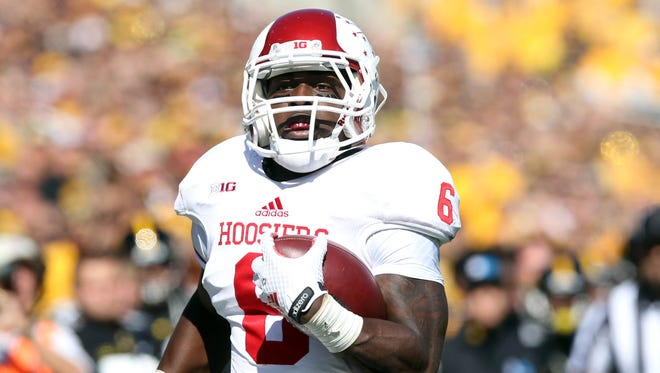 Indiana Hoosiers running back Tevin Coleman (6) runs for a touchdown against the Iowa Hawkeyes at Kinnick Stadium.