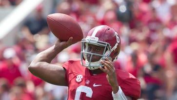 Alabama Crimson Tide quarterback Blake Sims (6) passes against the Florida Atlantic Owls at Bryant-Denny Stadium.