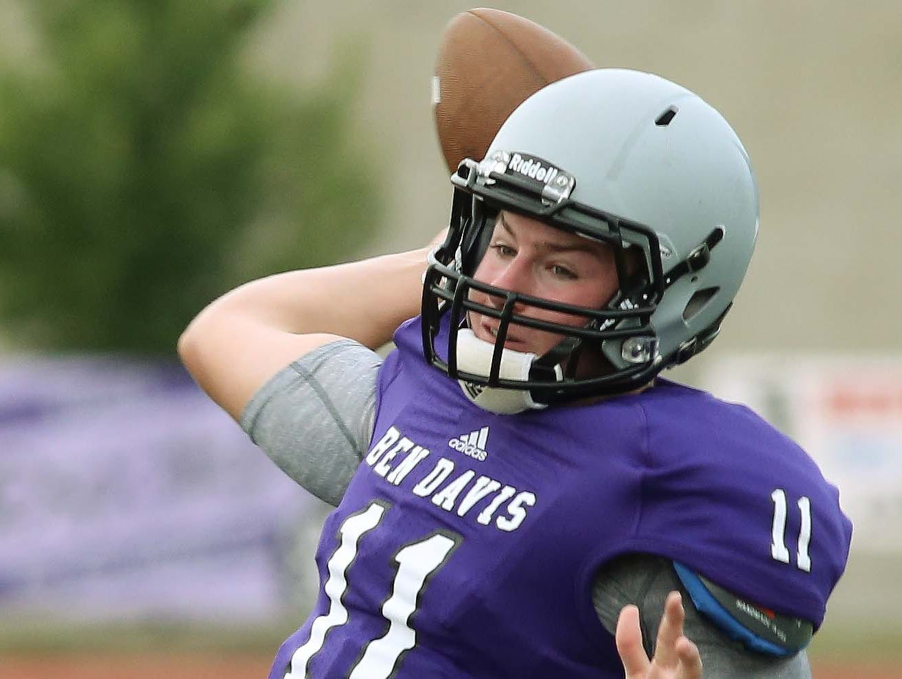 Kyle Castner of Ben Davis winds up for a throw down field. Ben Davis hosted Westfield in a football scrimmage August 15, 2014.