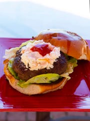 The winning Biloxi Butter Burger features a topping of shrimp spread with a dollop of cocktail sauce on top.