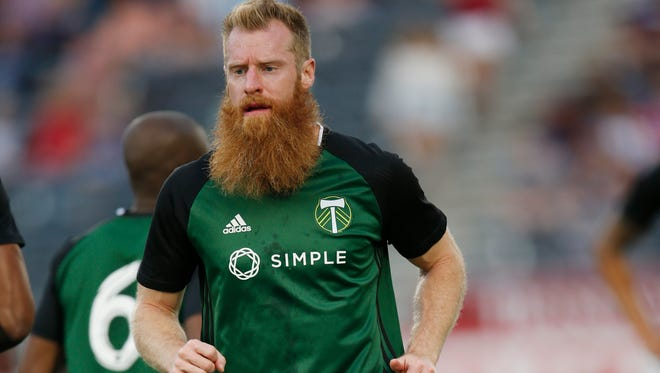 Portland Timbers defender Nat Borchers (7) warms up before the first half of a Major League Soccer match Monday, July 4, 2016, in Commerce City, Colo.