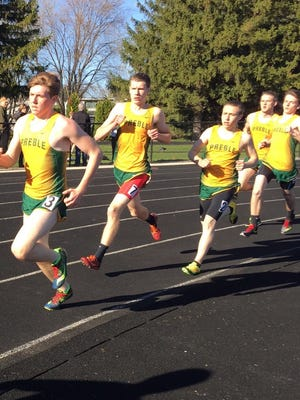 Green Bay Preble runners compete in the 1,600-meter race on April 29 at Green Bay Notre Dame. The Hornets have had 20 individuals run the mile in under 5 minutes this season.