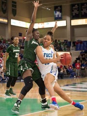 Erica Nelson of Florida Gulf Coast University drives past Brandi Buie of Jacksonville during the game at FGCU on Saturday afternoon, Jan. 28, 2017.