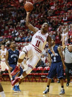 "Hoosier Kevin ""Yogi"" Ferrell spins and scores after being fouled in the first half but referees didn't count the bucket. Indiana hosted Northwood at Assembly Hall on Thursday, November 6, 2014."