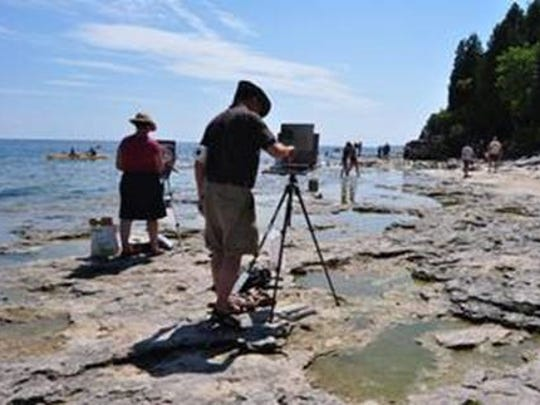 """Plein air painters from the Water's Edge Artists group  will again set up their easels along the Lake Michigan shore in Algoma to create watery works of art Friday and Saturday as part of the opening of the """"Art of Water"""" exhibit at James May Gallery."""