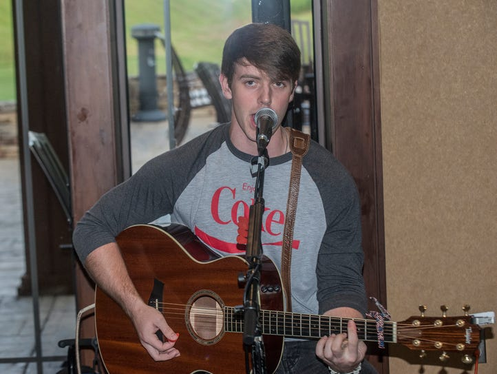 Country singer Ben Norris of Millbrook performs at