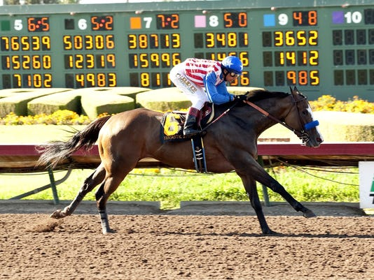 In a photo provided by Benoit Photo, Fantastic Style and jockey Rafael Bejarano win the Grade II, $200,000 Great Lady M. Stakes horse race Saturday, July 11, 2015, at Los Alamitos Race Course in Cypress, Calif. (Benoit Photo via AP)