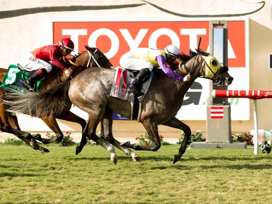 In a photo provided by Benoit Photo, Hunt and jockey Flavien Prat, right,win the Del Mar Handicap horse race ahead of Itsinthepost, left, with Tyler Baze, Saturday, Aug. 19, 2017, at Del Mar Thoroughbred Club in Del Mar, Calif. (Benoit Photo via AP)