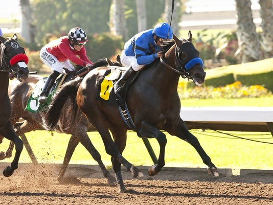 In a photo provided by Benoit Photo, Sky Kingdom and Victor Espinoza win the $75,000 American Flag Stakes horse race Friday, July 4, 2014, at Los Alamitos Race Course in Cypress, Calif. (AP Photo/Benoit Photo)
