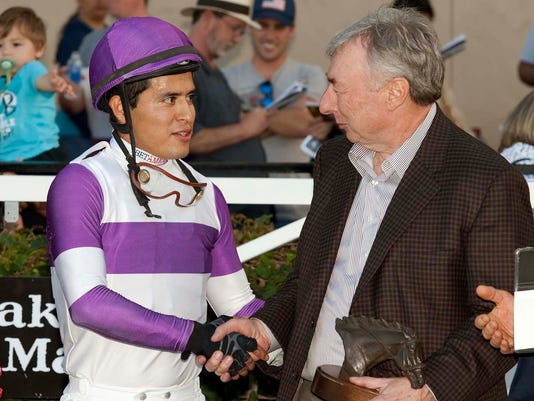 This photo provided by Benoit Photo shows owner J. Paul Reddam, right, celebrating with jockey Mario Gutierrez, after More Complexity's victory in the $100,000 Betty Grable Stakes, Sunday, Nov. 9, 2014 at Del Mar Thoroughbred Club in Del Mar, Calif. (AP Photo/Benoit Photo)