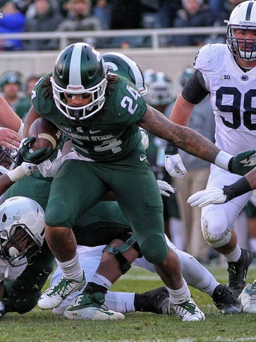 Michigan State running back Gerald Holmes (24) surges