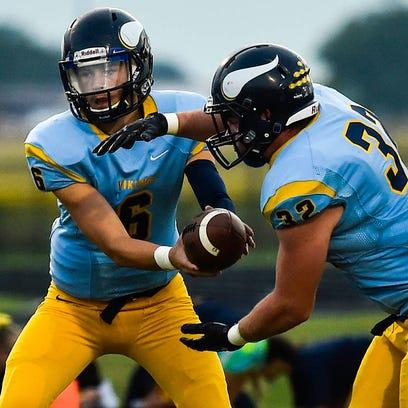 River Valley quarterback Josh Ellwood hands off to
