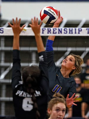 Frenship's Gracie Harrison (11) hits the ball over the net during the game against Odessa Permian, Tuesday, Oct. 6, 2020, at the Tiger Pit in Wolfforth, Texas.
