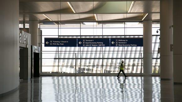 A worker walks through Terminal 3 at Phoenix Sky Harbor