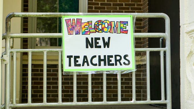 A banner welcomes new Lafayette Parish teachers to training sessions July 30, 2018, at Lafayette Middle School.