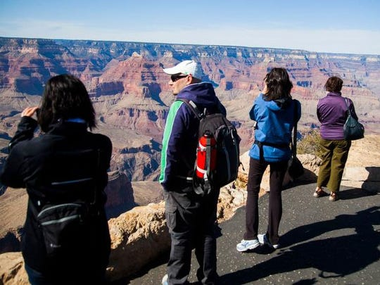 For some people, admiring the view from the rim is enough. These tourists are at Powell Point at the South Rim.
