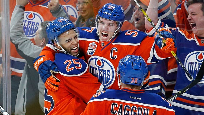 Edmonton Oilers captain Connor McDavid (97) celebrates a short-handed goal in the third period against the San Jose Sharks in Game 2 of the first-round series.
