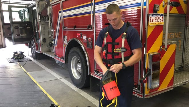 A York City Fire/Rescue Services firefighter preps some of the department's water rescue equipment ahead of a weekend rainstorm.