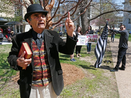 Brother Jed Smock preaches outside the Plaster Student