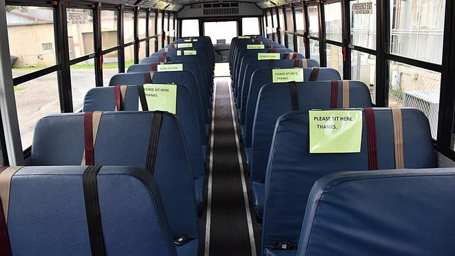 In one of the Alachua County Public Schools' new buses, signs on seats tell students where they can sit. The district bought 80 new buses for the coming school year. While 50 is the maximum amount of students allowed per bus, the goal is 30 to 35 students, with siblings sitting together.