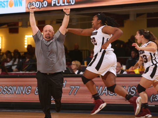 Ossining coach Dan Ricci celebrates as time runs out and Ossining defeats Magnus  80-77 to win the Section 1 Class AA championship at the Westchester County Center in White Plains March 5, 2017.