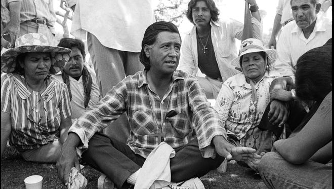 Cesar Chavez, center, speaks with workers near Camp Roberts in south Monterey County in 1975.