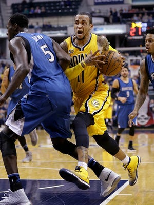 Indiana Pacers guard Monta Ellis (11) drives behind Minnesota Timberwolves forward Gorgui Dieng (5) in the first half of their game Tuesday, March 28, 2017, evening at Bankers Life Fieldhouse.  The Indiana Pacers lost to the Minnesota Timberwolves 115-114.