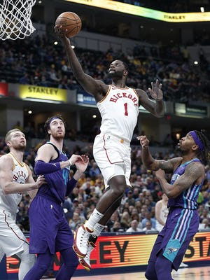 Indiana Pacers guard Lance Stephenson (1) drives by Charlotte Hornets guard Julyan Stone (32) in the first half of their game at Bankers Life Fieldhouse on Tuesday, April 10, 2018.