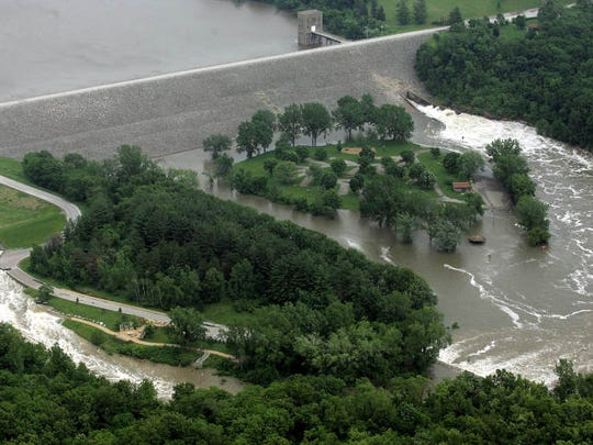 PC photo by Dan Williamson. 6-12-08. Floodwaters flow over the Coralville Reservoir emergency spillway and through the Devonian Fossil Gorge, left, to meet up with water flowing through the dam on the Iowa River on June 12, 2008.