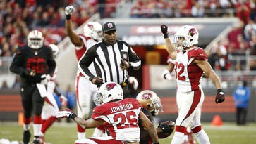 Arizona Cardinals' Rashad Johnson (26) tackles San Francisco 49ers Anquan Boldin (81) 2-yards short of a first down on fourth down to end the 49ers chances in the 4th quarter on Nov. 29, 2015 in Santa Clara, Calif.